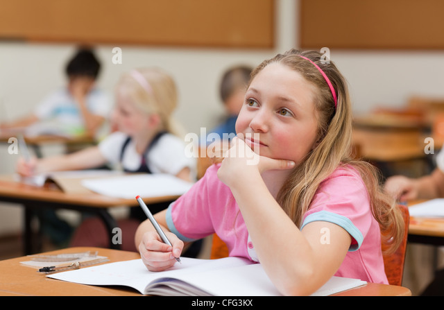 Elementary student in thoughts - Stock Image