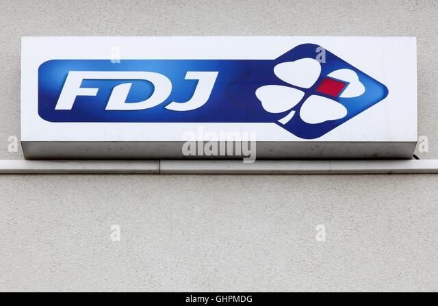 Francaise des Jeux also called FDJ logo on wall - Stock Image