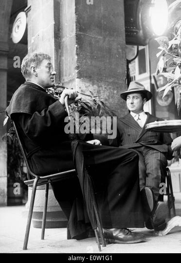 Actor Alec Guinness in a film as Father Brown - Stock Image