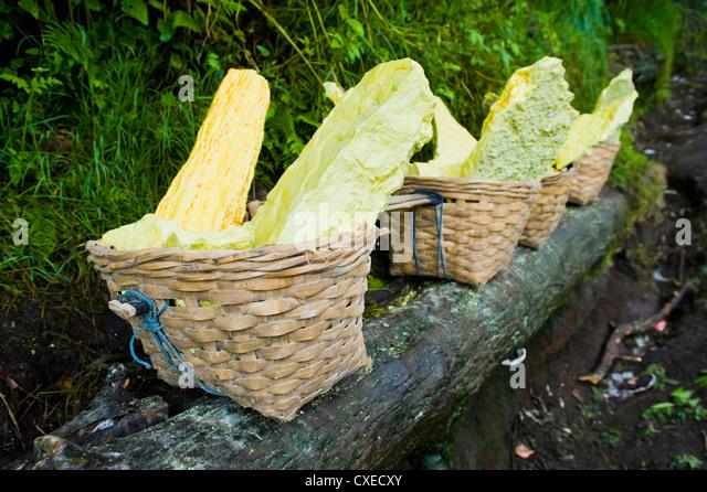 Baskets of bright yellow sulphur, Kawah Ijen, Java, Indonesia, Southeast Asia, Asia - Stock Image