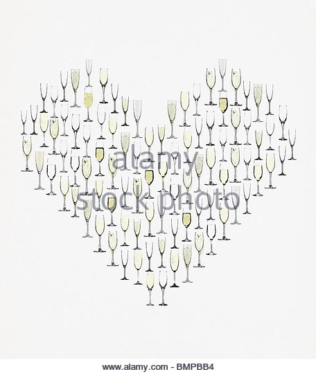 Champagne flutes forming heart - Stock Image