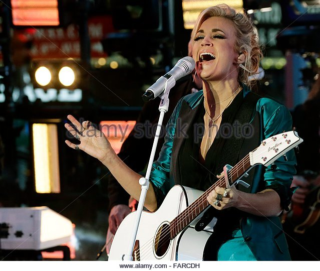epa05085058 US Country music singer Carrie Underwood performs before New Year's Eve in New York's Times - Stock Image