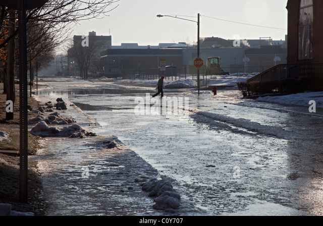 Findlay, Ohio - After heavy rain and snow melt, the Blanchard River overflows its banks, flooding downtown streets. - Stock Image