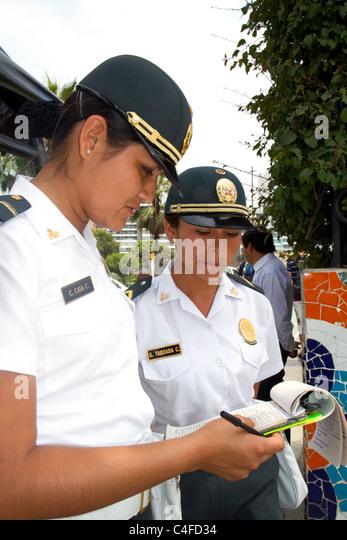 Female peruvian police officers in Lima, Peru. - Stock Image