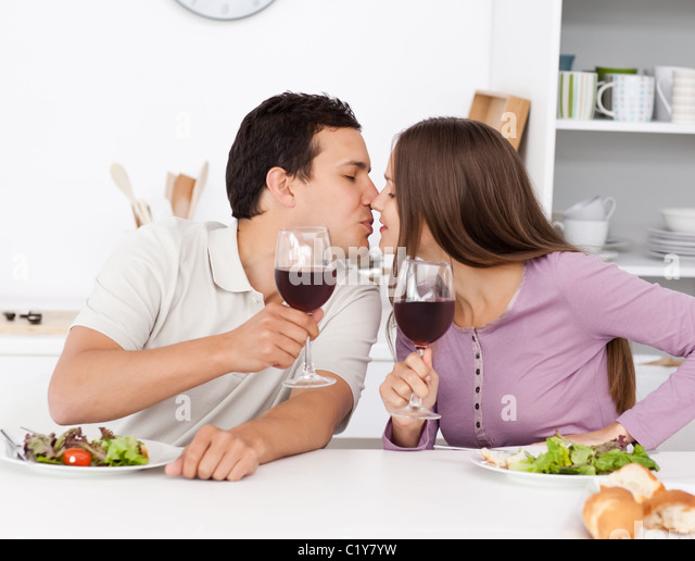 Cute couple giving a toast while having lunch - Stock-Bilder