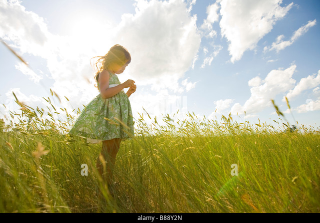 Girl in a Grassy Field in North Dakota - Stock Image