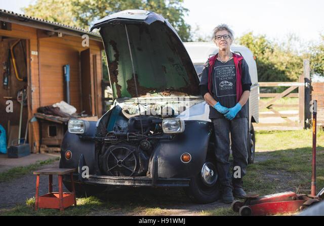 Portrait of an elderly female car mechanic - Stock-Bilder