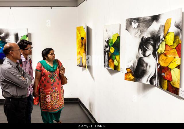 Mumbai India Indian Asian Fort Mumbai Kala Ghoda Jehangir Art Gallery contemporary paintings man woman couple son - Stock Image