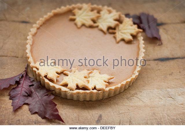 Maple leaf cookies on pumpkin pie - Stock Image