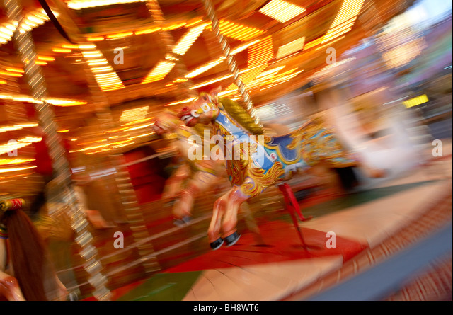 Merry go-round moving - Stock-Bilder