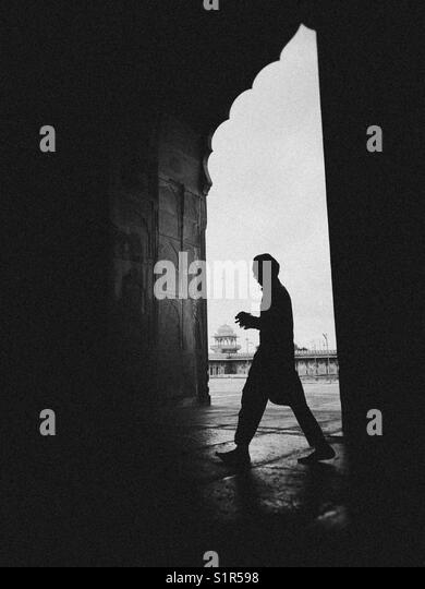 A boy walks in mosque / madrasah of Bhopal - Stock Image