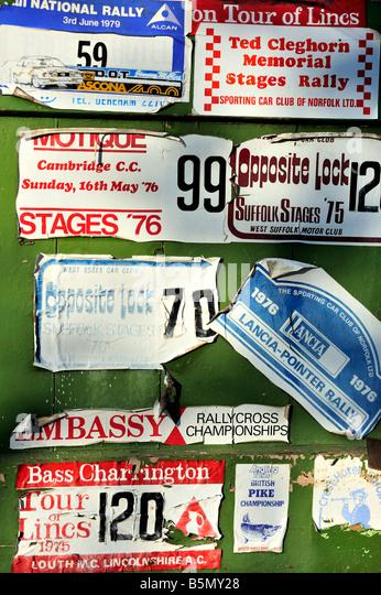 Rally plates on a garage door - Stock Image