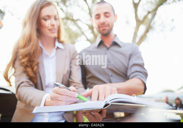 Businessman and business woman with paperwork - Stock-Bilder