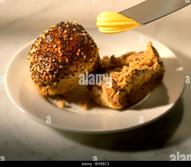 BROWN SEEDED ROLL WITH SPREAD - Stock Image