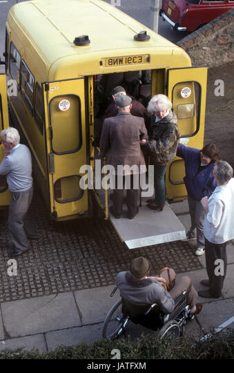 elderly people being transported by bus to day centre - Stock Image