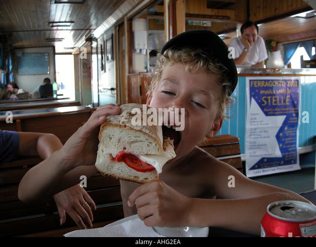Greedy Boy - Stock Image