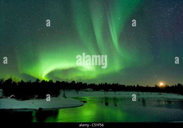 Northern Lights, also known as Aurora Borealis at moonset near Inari. Lapland, Finland. - Stock-Bilder