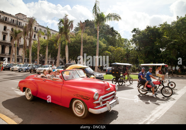 Havana, Cuba Street scene with old american car and bicycle taxi, Parque Centrale, Havana, Cuba, Caribbean, Latin - Stock Image