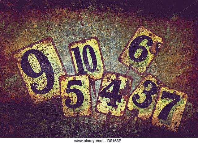 rusty metal numbers - Stock Image