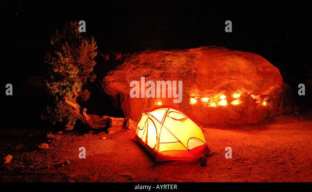 Illuminated tent at a campsite, nighttime, Canyonlands National Park, Utah, USA - Stock-Bilder