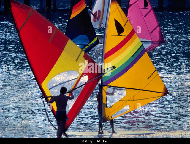 Young windsurfers crisscross as they practice maneuvering techniques for this popular water sport in Dana Point - Stock Image