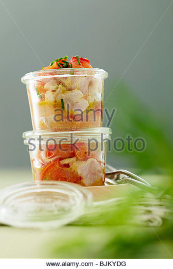 Seabream with tomatoes, poached in jars - Stock Image