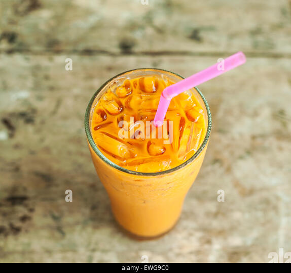 Ice milk tea, famous drink on old wood table, Grunge background - Stock Image