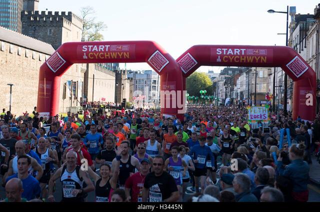 Runners take part in the Cardiff Half Marathon - Stock Image