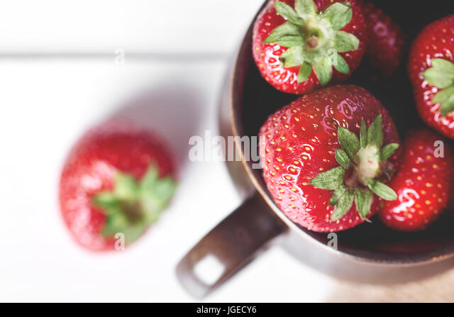 Sweet strawberries in the cup - Stock Image