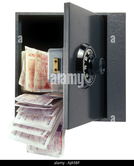 Safe with combination dial with money pouring out - Stock Image