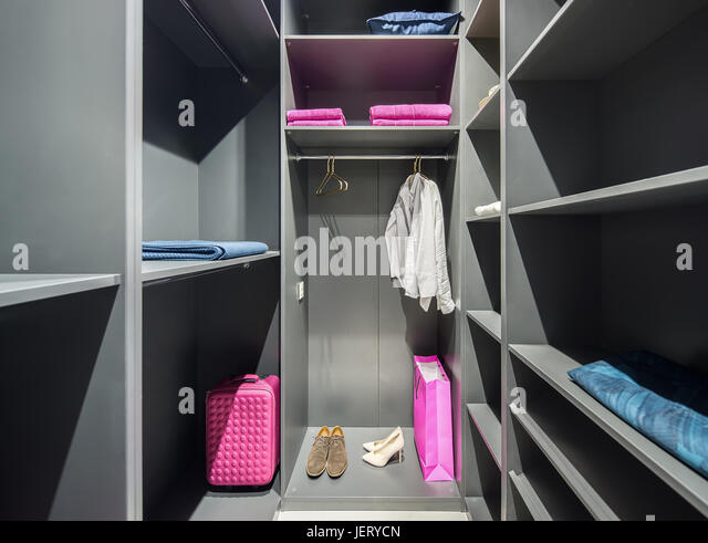 Good Illuminated Gray Walk In Closet With Many Shelves. There Are Shoes, Shirts,