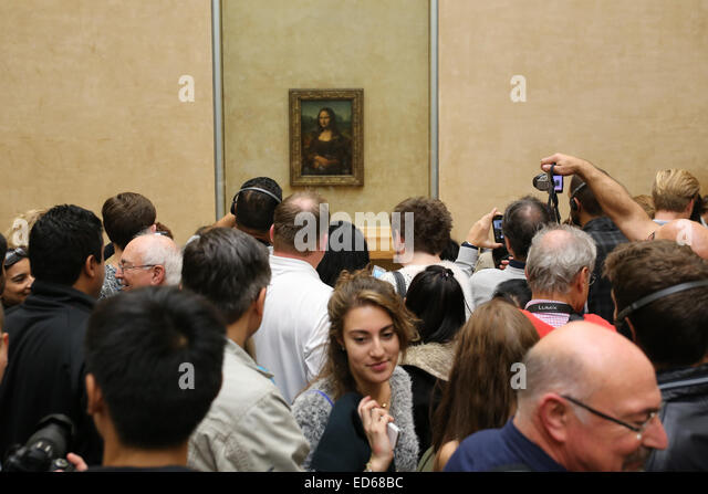 Louvre museum Mona Lisa tourists people congested - Stock Image