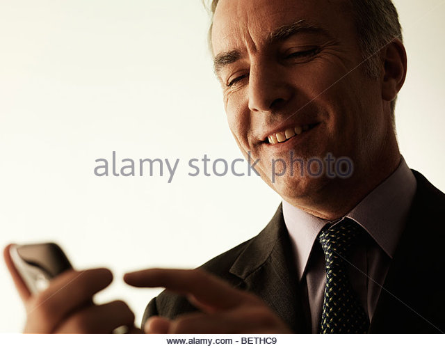 businessman using mobile technology - Stock Image