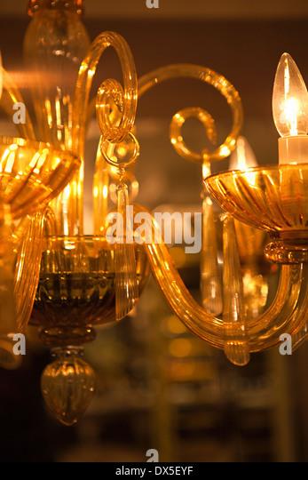 Illuminated crystal wall sconce lights, close up - Stock Image