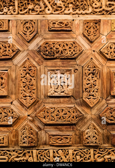 Old ornate wooden door on display Sharjah Museum of Islamic Civilization in Sharjah United Arab Emirates - Stock Image