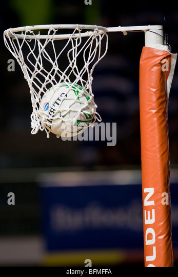Netball in hoop - Stock Image