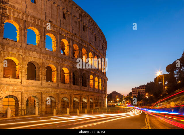 Rome Colosseum or Flavian Amphitheatre at night with light trails Rome Lazio Region Italy EU Europe - Stock Image