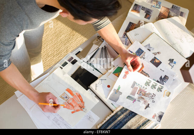 Fashion designer drawing sketch - Stock Image