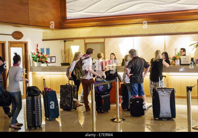 Waikiki Beach Honolulu Hawaii Hawaiian Oahu Kuhio Avenue Hilton hotel lobby front desk checking in out guests line - Stock Image