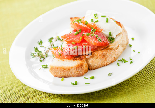 Bruschetta with soft cheese and smoked salmon - Stock Image
