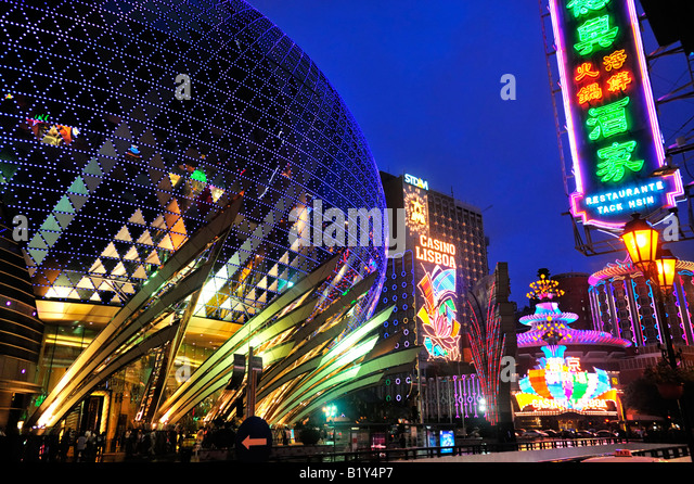 Evening view of spectacular new Grand Lisboa Casino and famous Lisboa Casino and Hotel in Macau China 2008 - Stock Image
