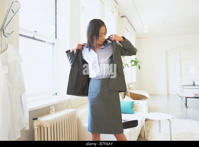 woman getting dressed for work stock photos amp woman