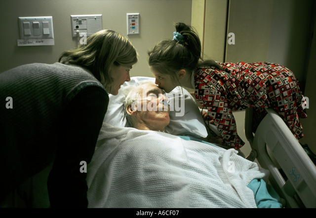 daughter and grand daughter comforting grand father in hospital - Stock-Bilder