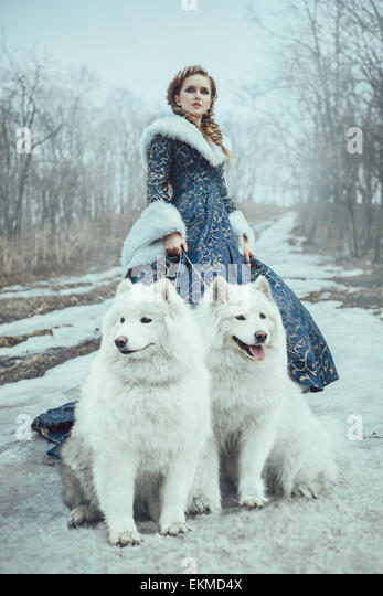 The woman on winter walk with a dog - Stock Image