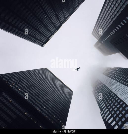 Directly Below Shot Of Modern Buildings - Stock Image