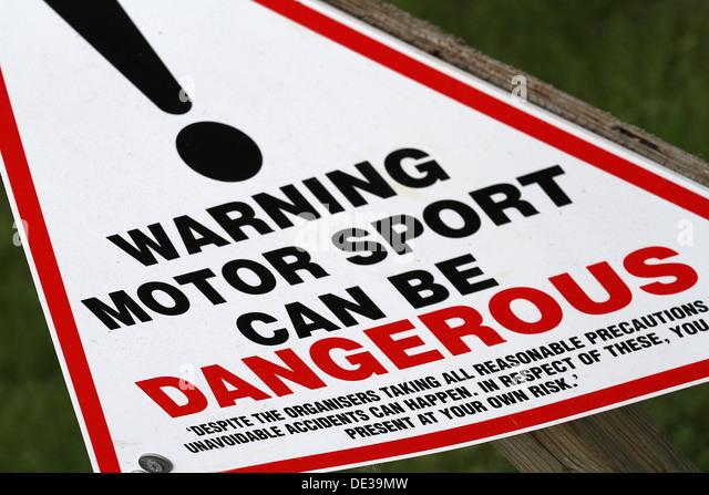 Warning sign for danger of motor sport. - Stock Image