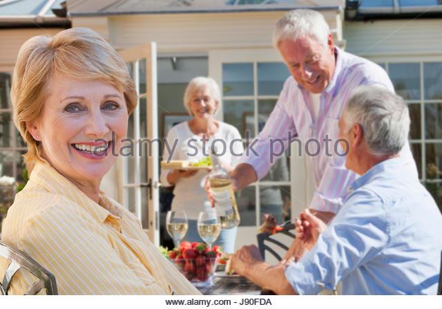 Group Of Senior Friends Enjoying Outdoor Meal Together - Stock-Bilder