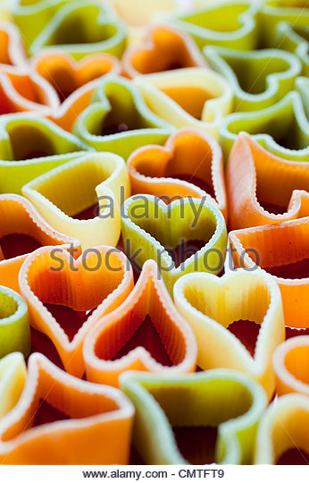 Heart-shaped pasta in different colors - Stock Image
