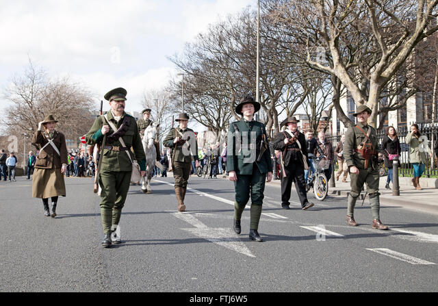 Actors portraying the 1916 Easter Rising leaders marching through Dublin city, Ireland. - Stock Image