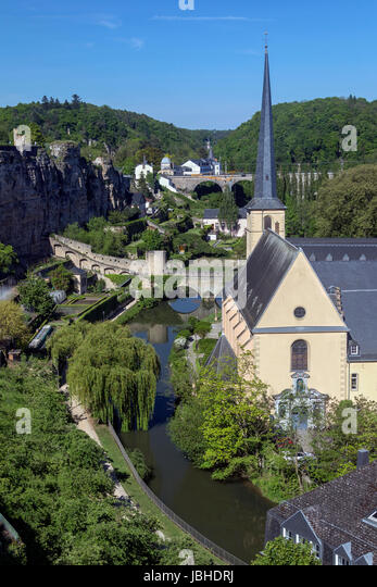 Luxembourg City - Ville de Luxembourg. St John Neimenster and the walls of the old town viewed from the Grund area - Stock Image